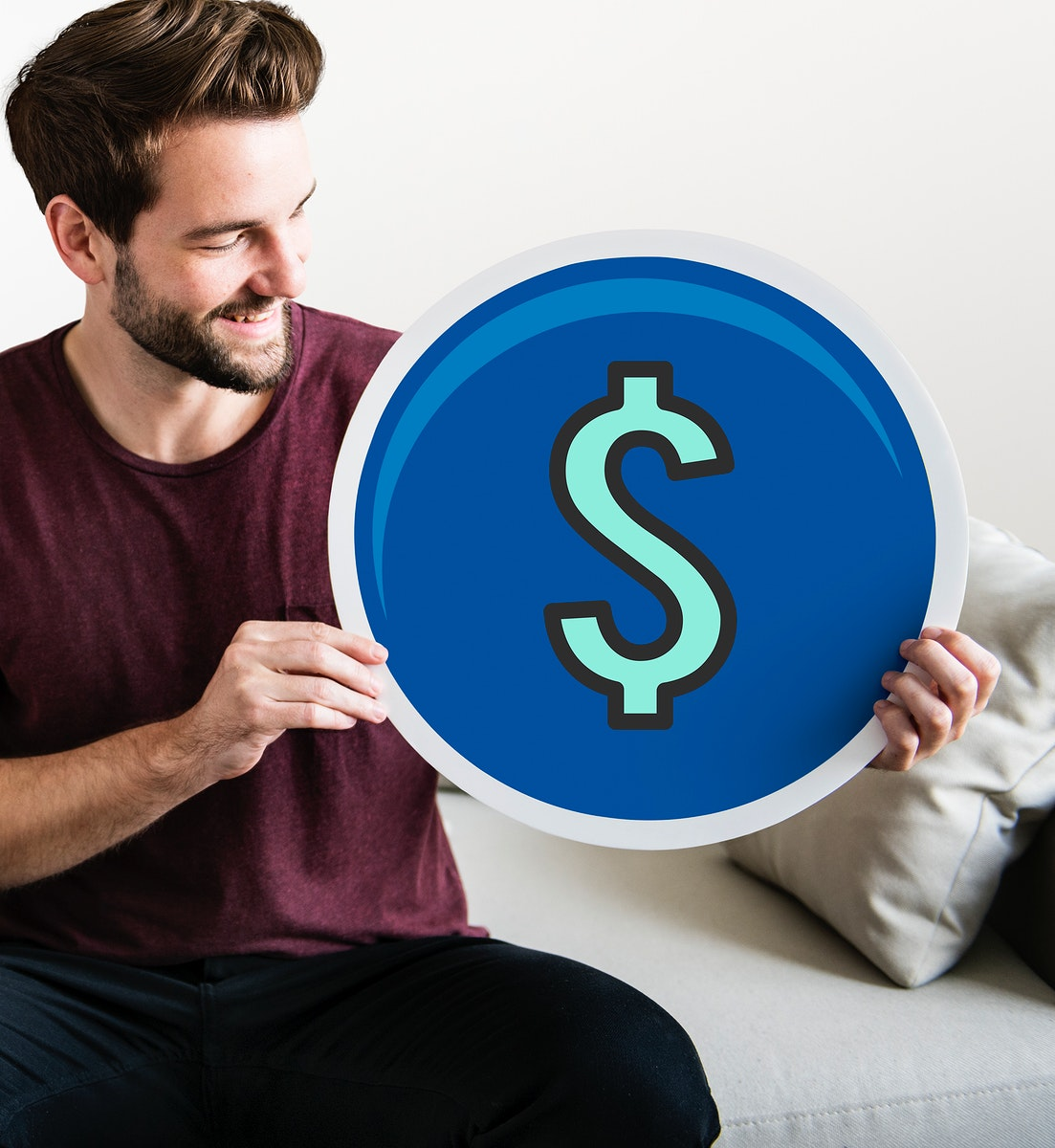 Young man holding a dollar icon