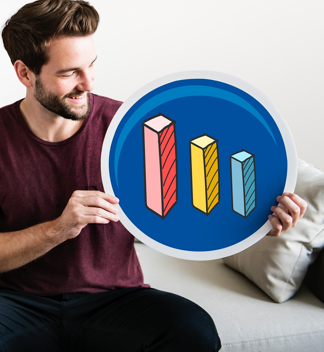 Young man holding a bar graph icon