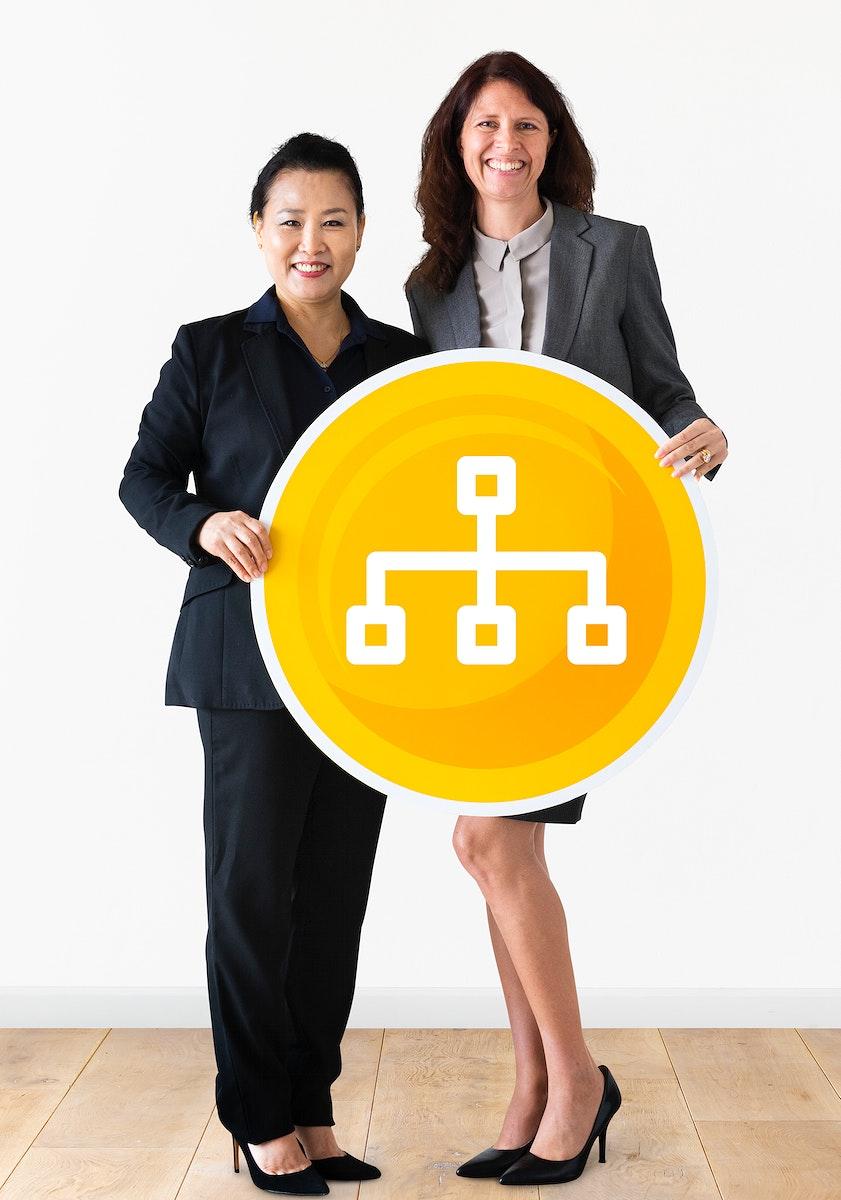 Businesswomen holding a organizational chart icon