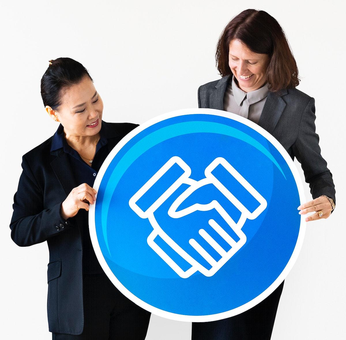 Businesswomen holding a handshake icon