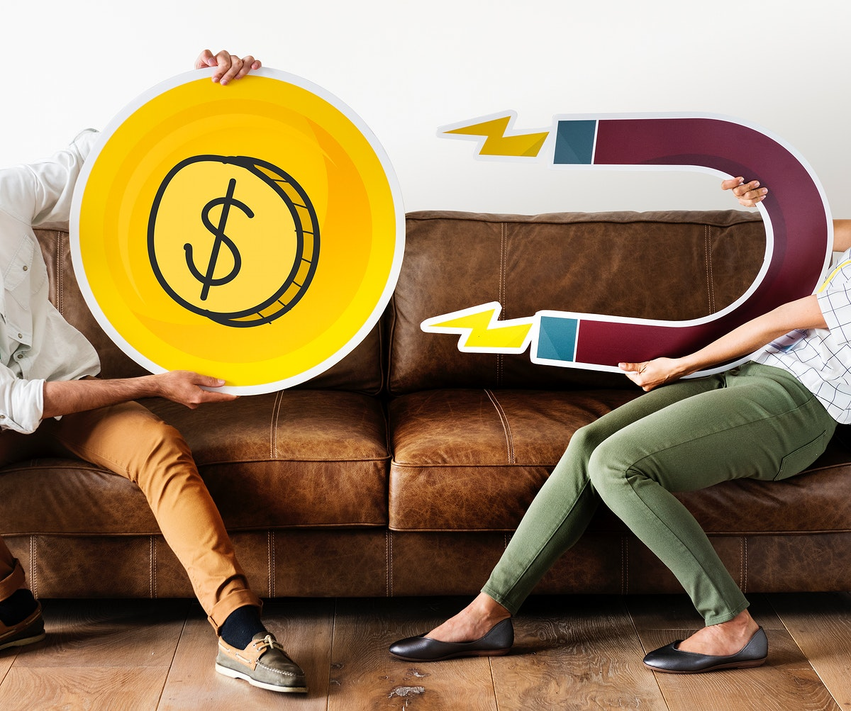 People holding financial icon and a magnet