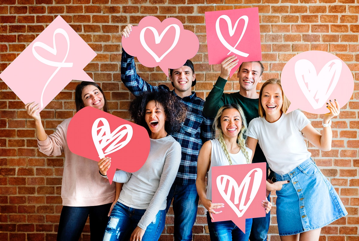 Young adult friends holding heart icons