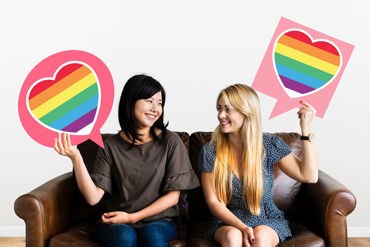 Couple holding speech bubbles with LGBT heart icons