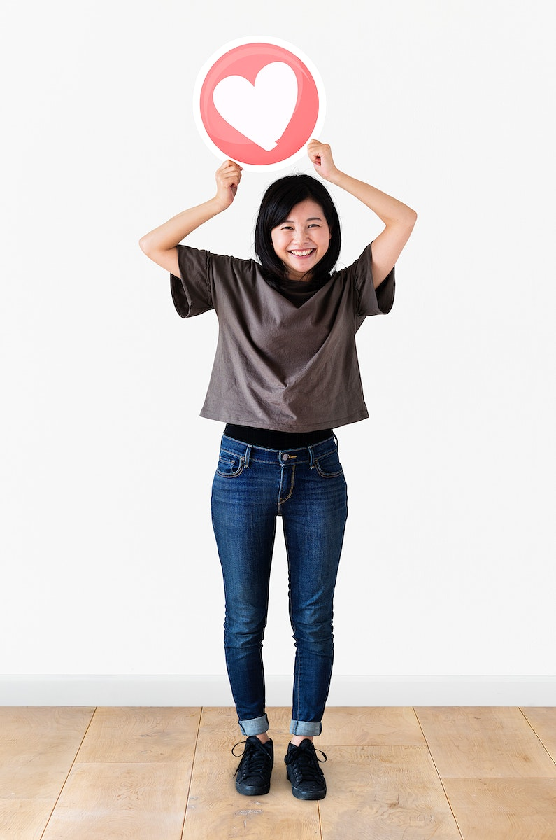 Japanese woman holding up a heart