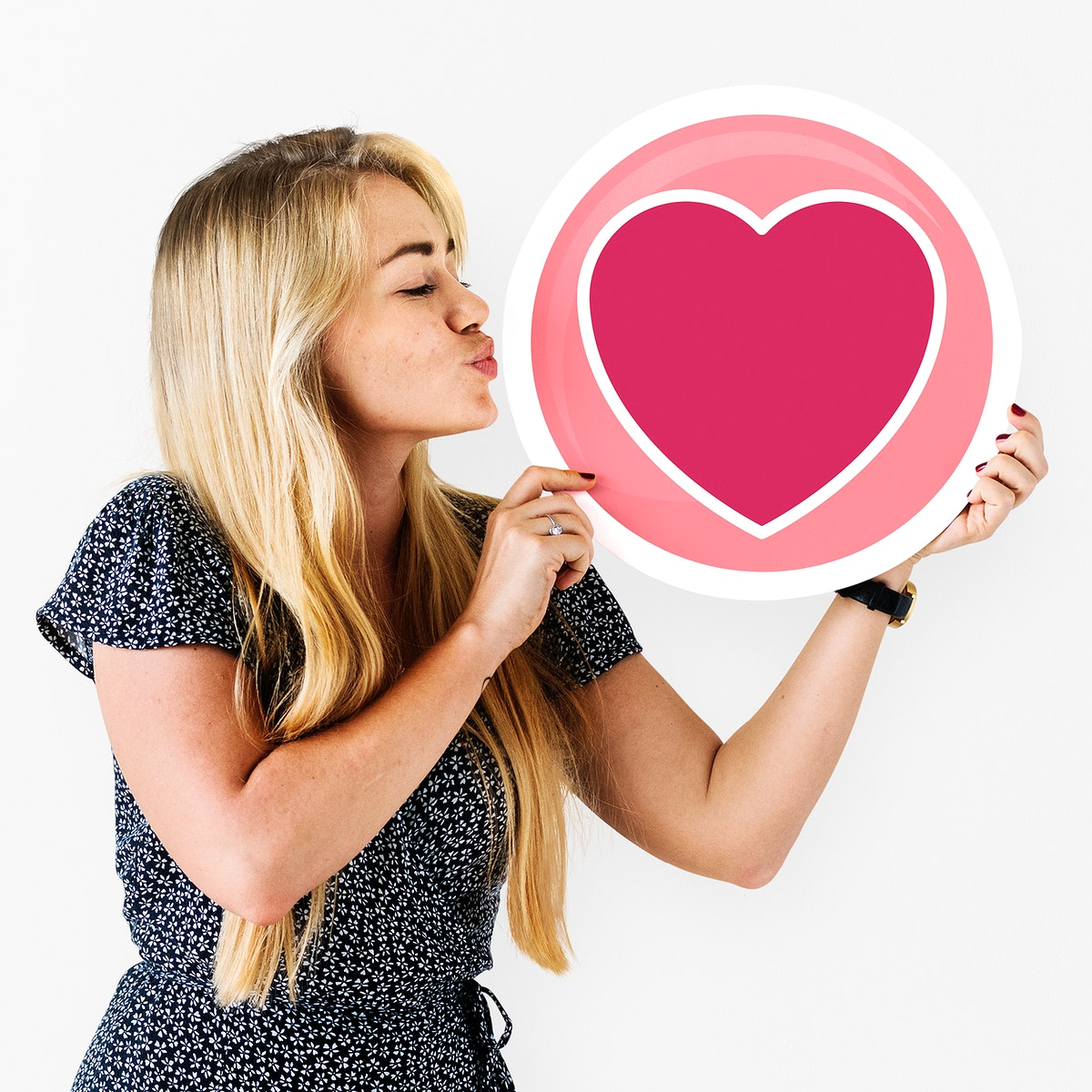 Blond woman holding heart icon