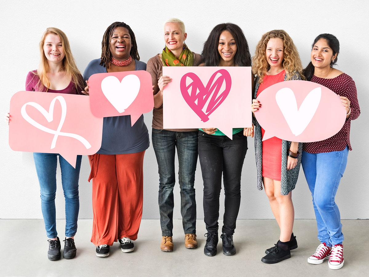 Group of women holding heart icons