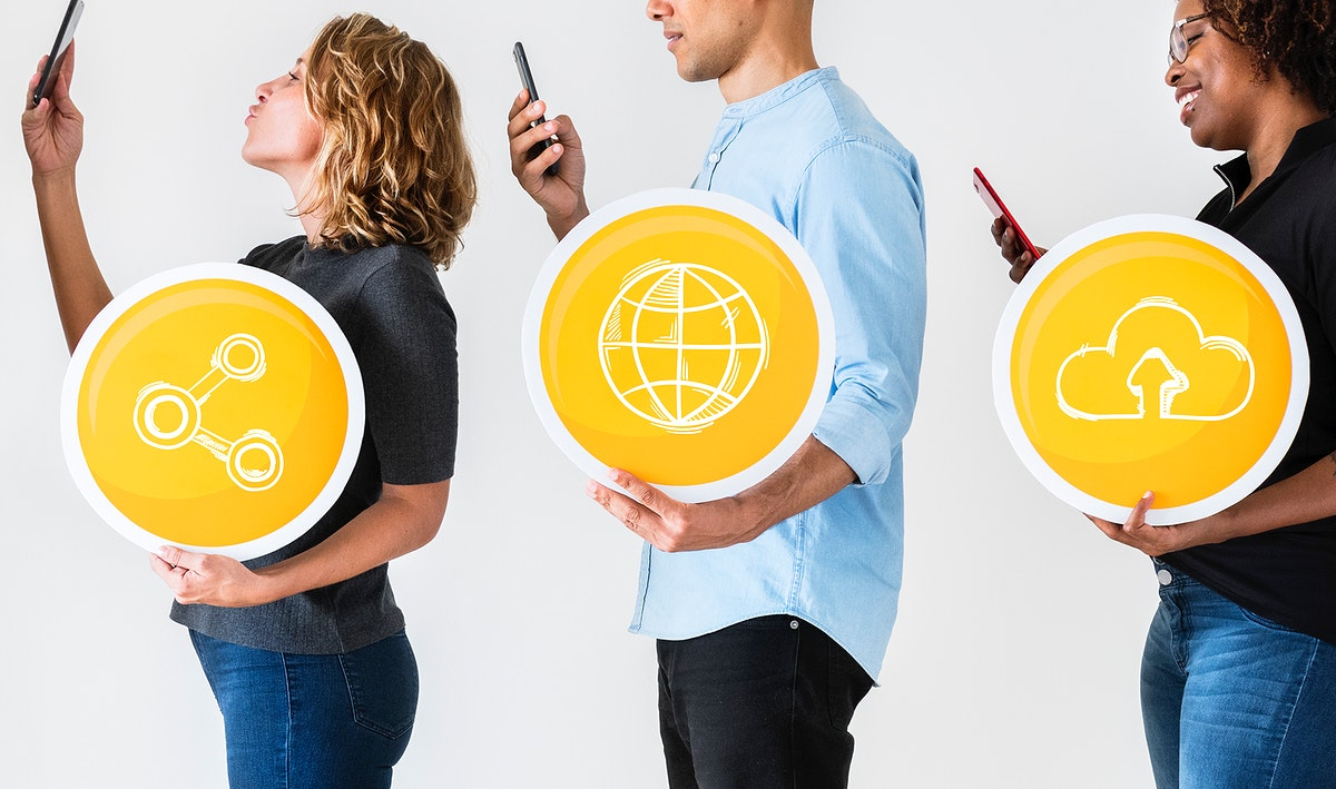 People using smartphones and holding technology signs