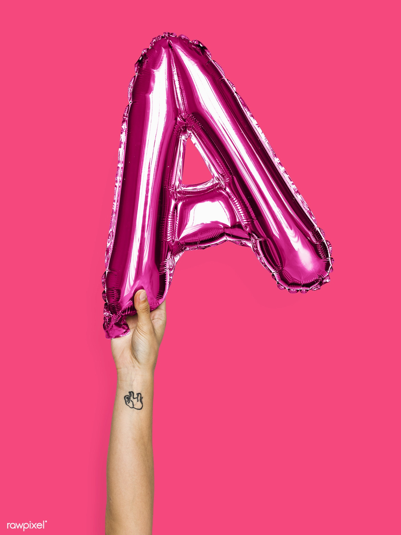 Hand holding balloon letter A - ID: 505495