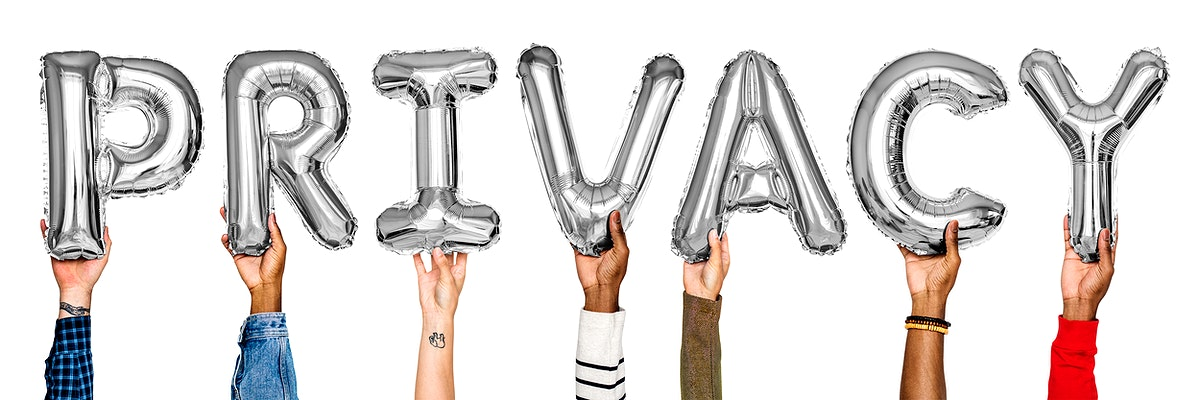 Silver alphabet helium balloons forming the text privacy