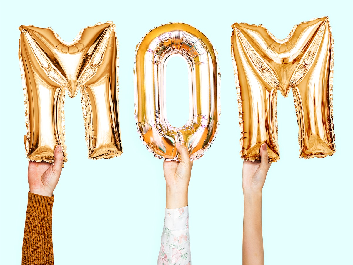 Hands showing mom balloons word