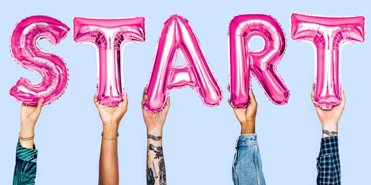 Hands holding start word balloon