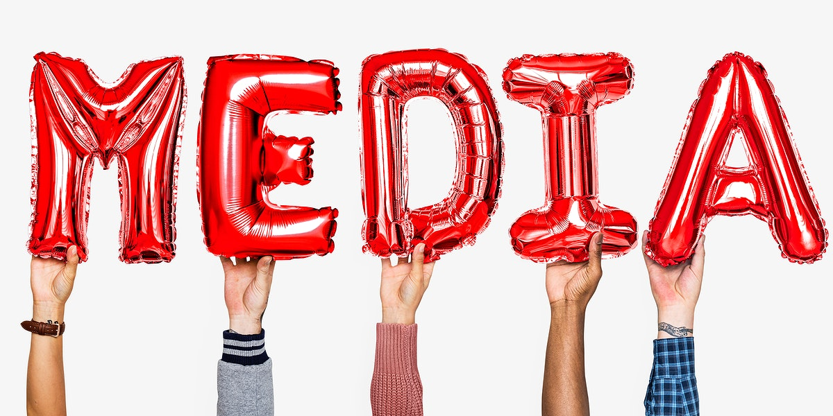 Red alphabet helium balloons forming the text media