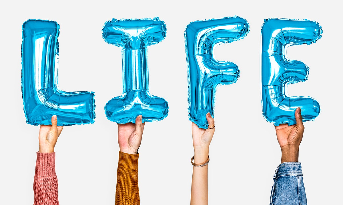 Hands showing life balloons word