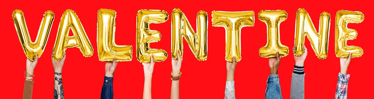 Yellow gold alphabet balloons forming the word valentine