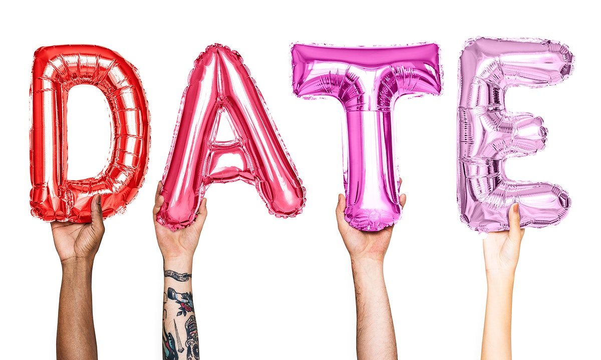 Pink alphabet balloons forming the word date