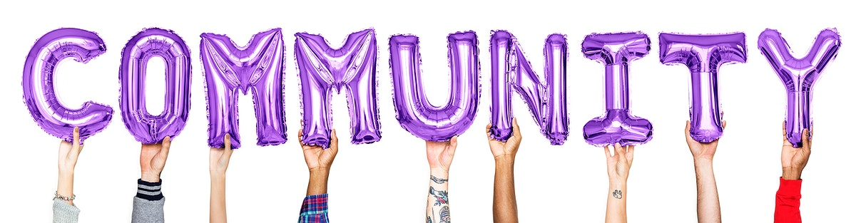 Purple alphabet balloons forming the word community