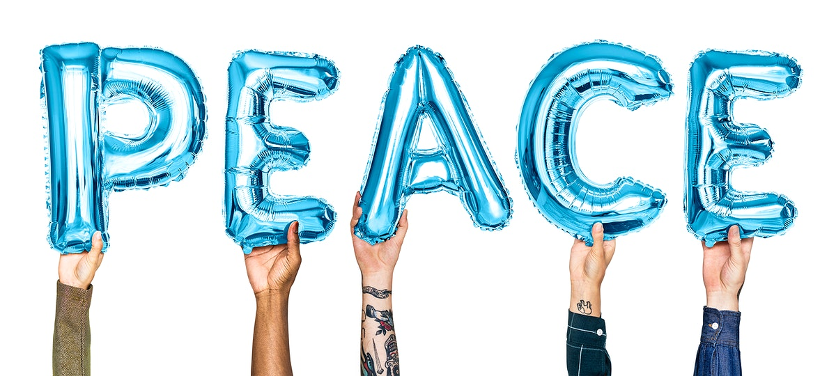 Blue alphabet balloons forming the word peace