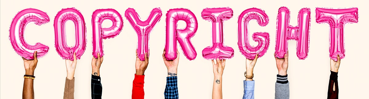 Pink balloon letters forming the word copyright