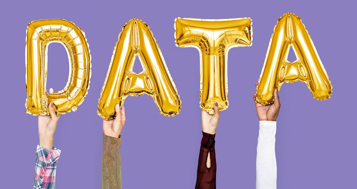 Golden balloon letters forming the word data