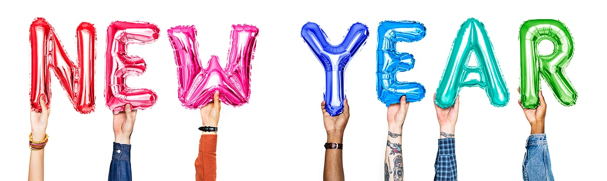 Hands holding balloons spelling New Year