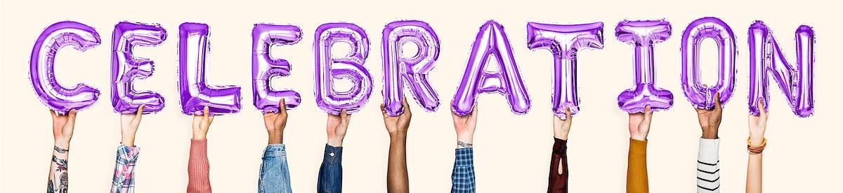 Hands holding balloons spelling Celebration