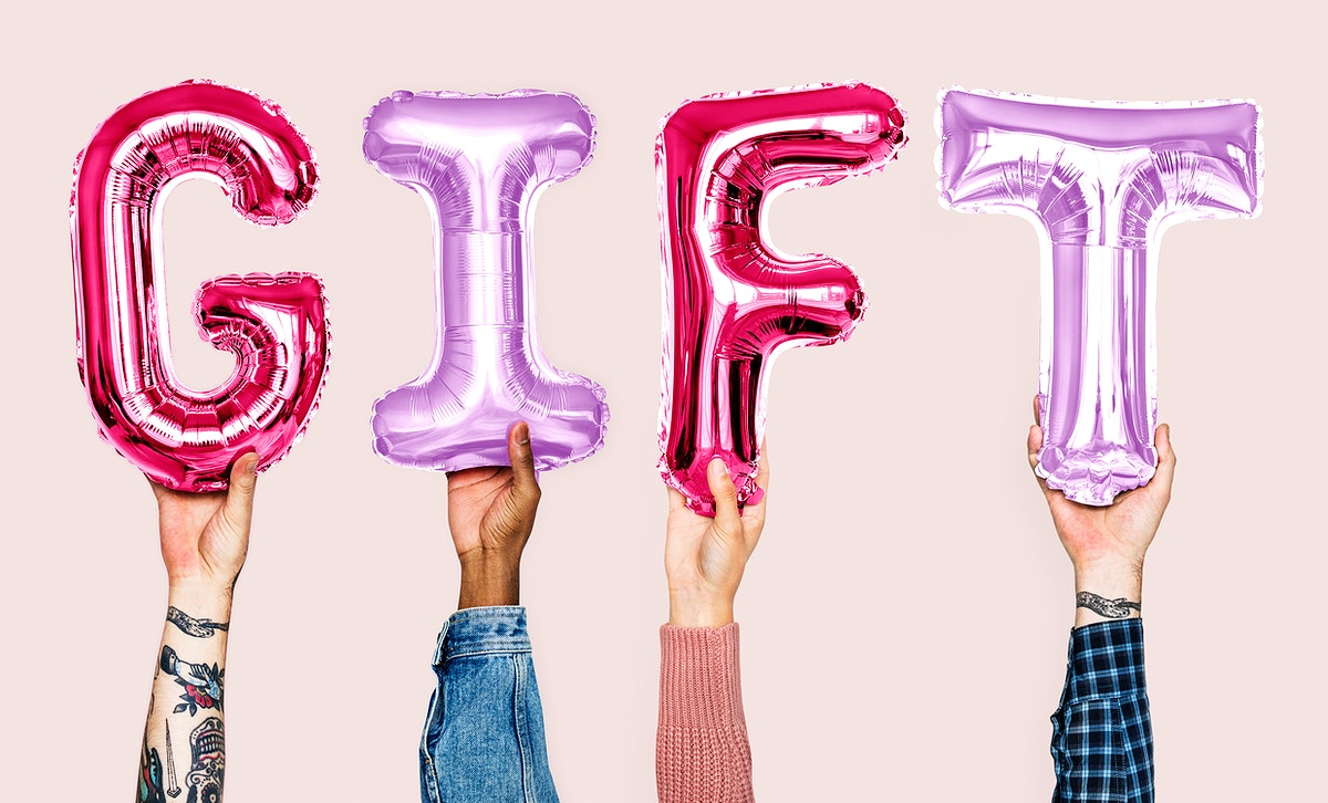 Hands showing gift balloons word