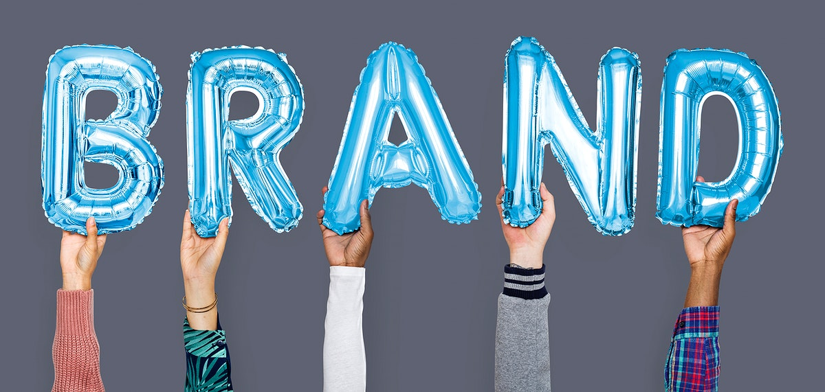 Hands showing brand balloons word