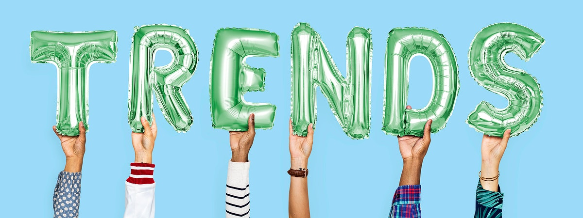 Green alphabet helium balloons forming the text trends