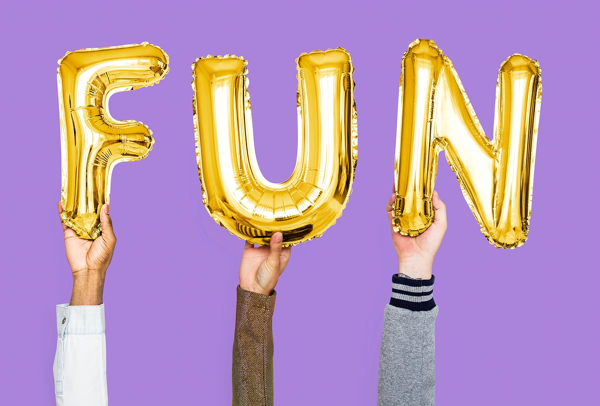 Yellow gold alphabet balloons forming the word fun