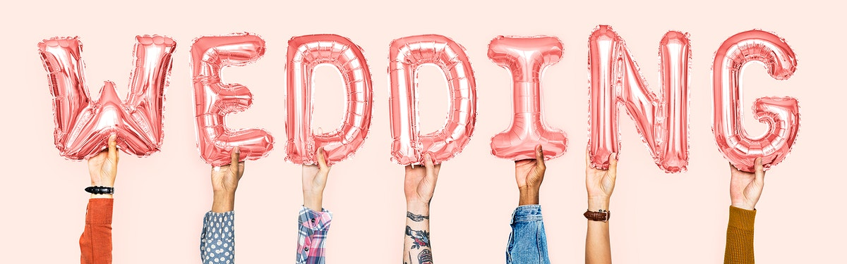 Pink alphabet balloons forming the word wedding