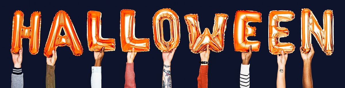 Orange alphabet balloons forming the word halloween