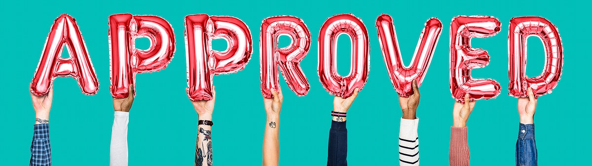 Hand holding balloons spelling Approved