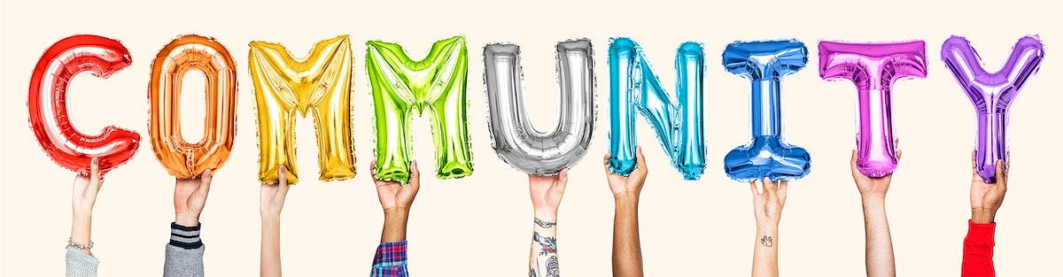 Rainbow alphabet balloons forming the word community