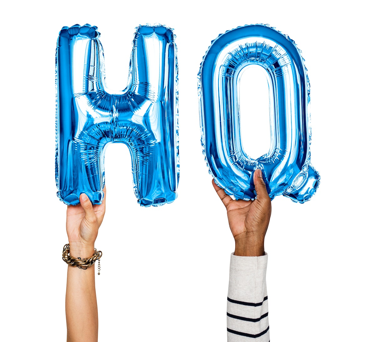 Hands holding balloons spelling HQ