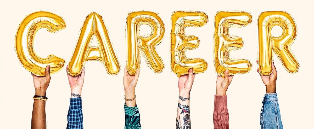 Hands holding balloons spelling Career