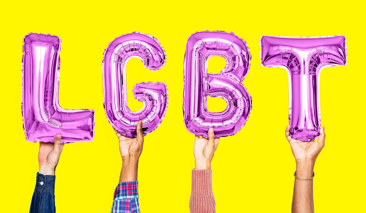 Purple alphabet balloons forming the word LGBT