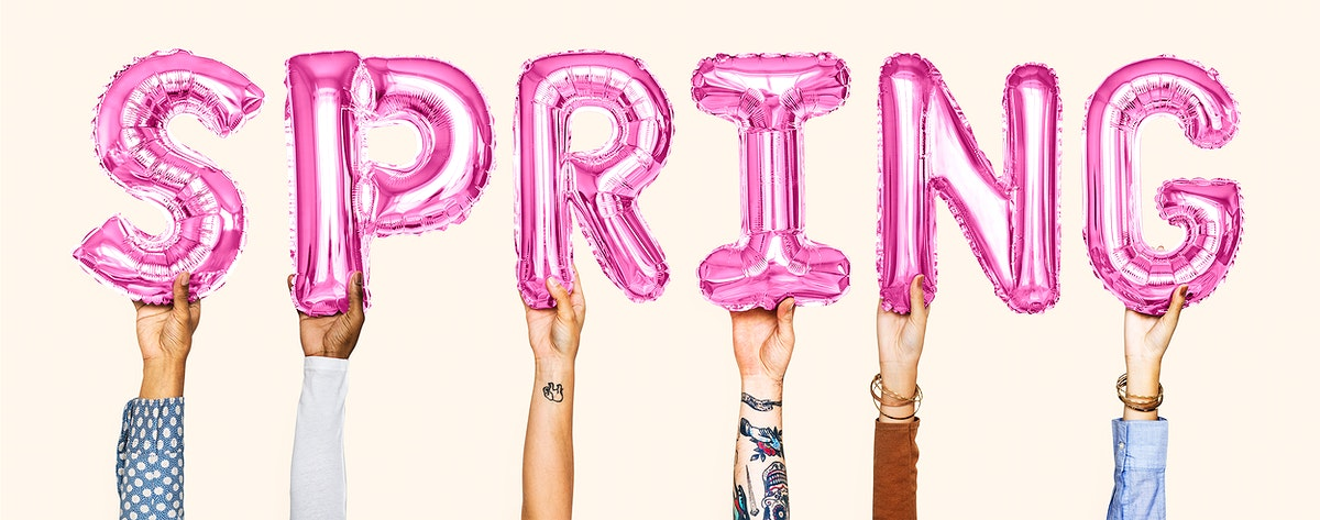 Hands holding balloons spelling the word Spring