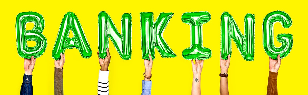 Green balloon letters forming the word banking