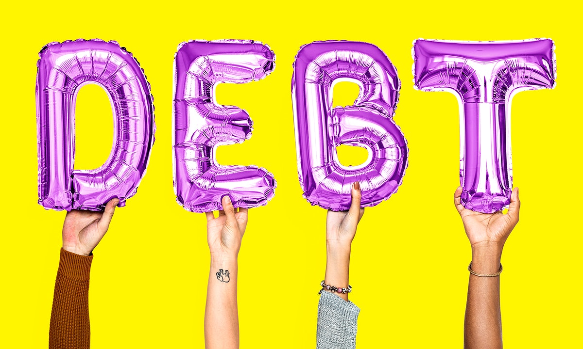 Purple balloon letters forming the word debt