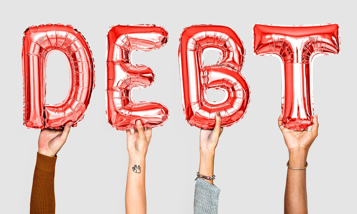 Red balloon letters forming the word debt