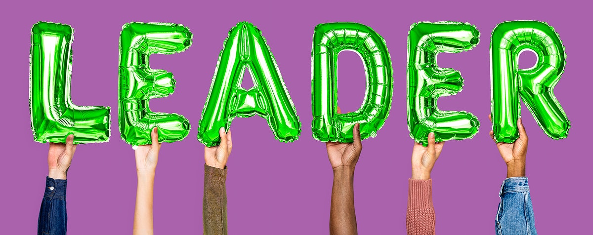 Green balloon letters forming the word leader