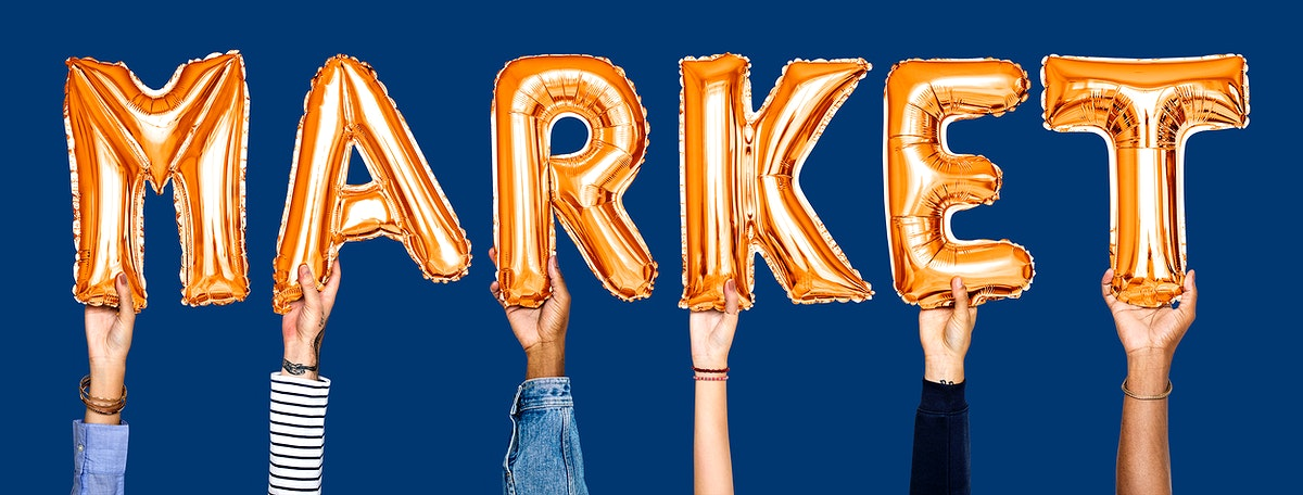 Orange balloon letters forming the word market