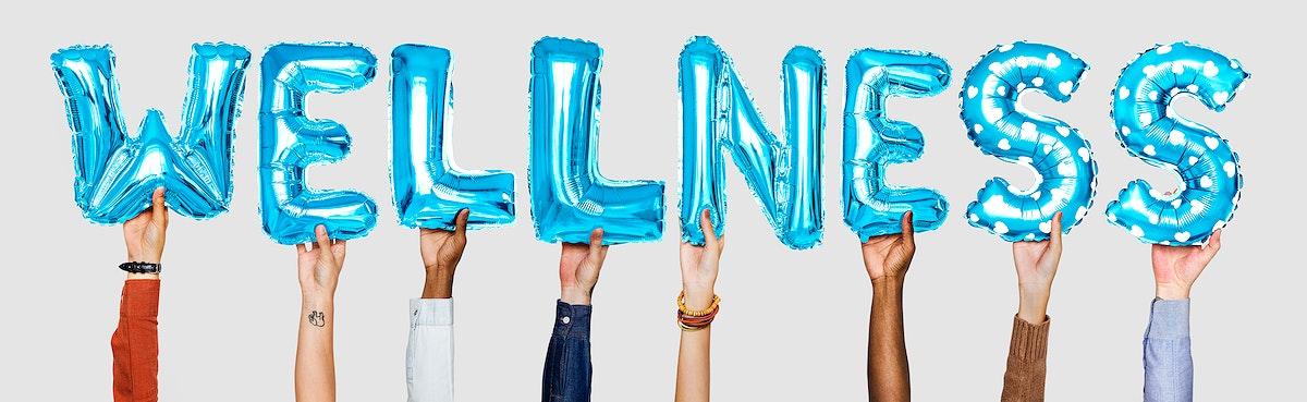 Hands showing wellness balloons word