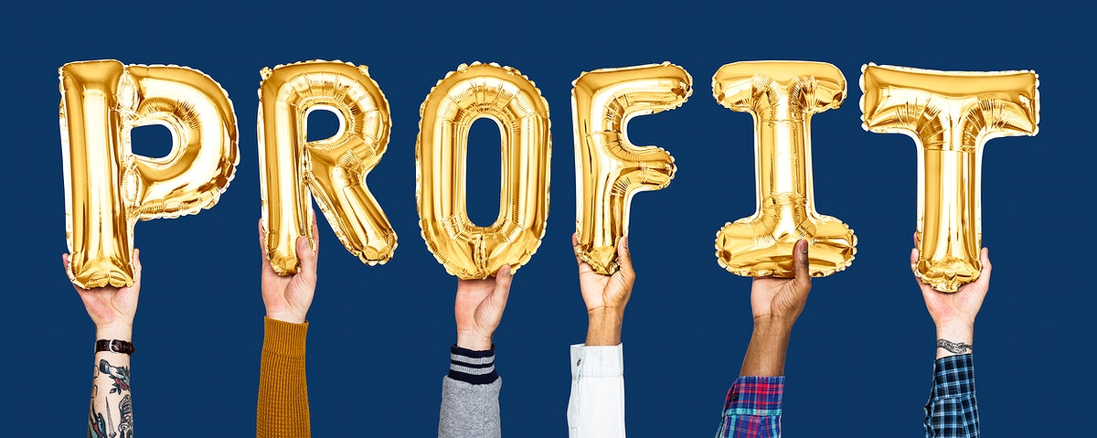Golden balloon letters forming the word profit