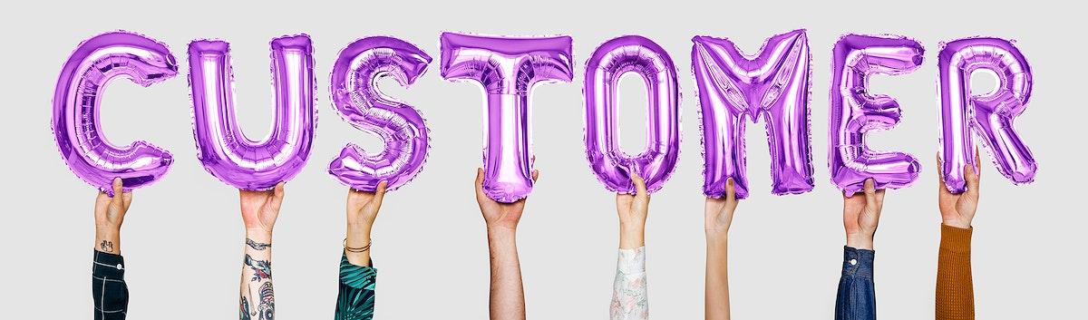 Purple alphabet balloons forming the word customer