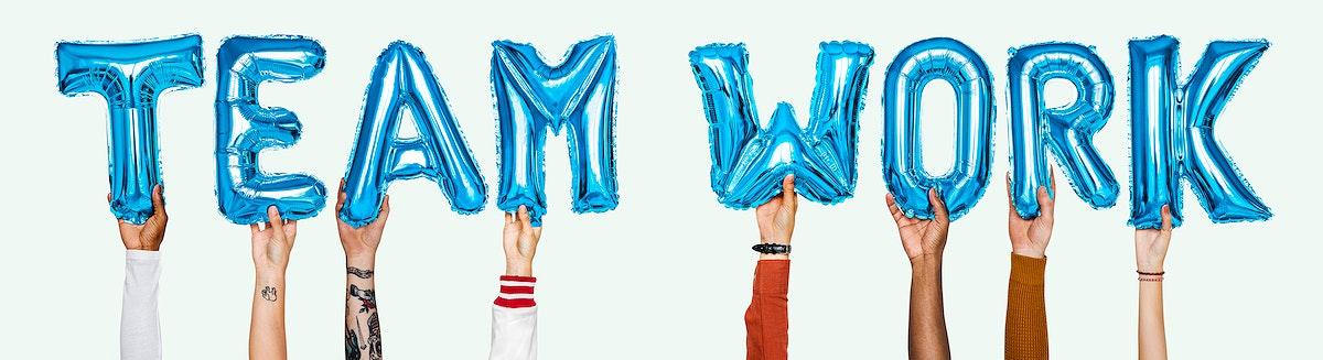 Blue alphabet helium balloons forming the text teamwork