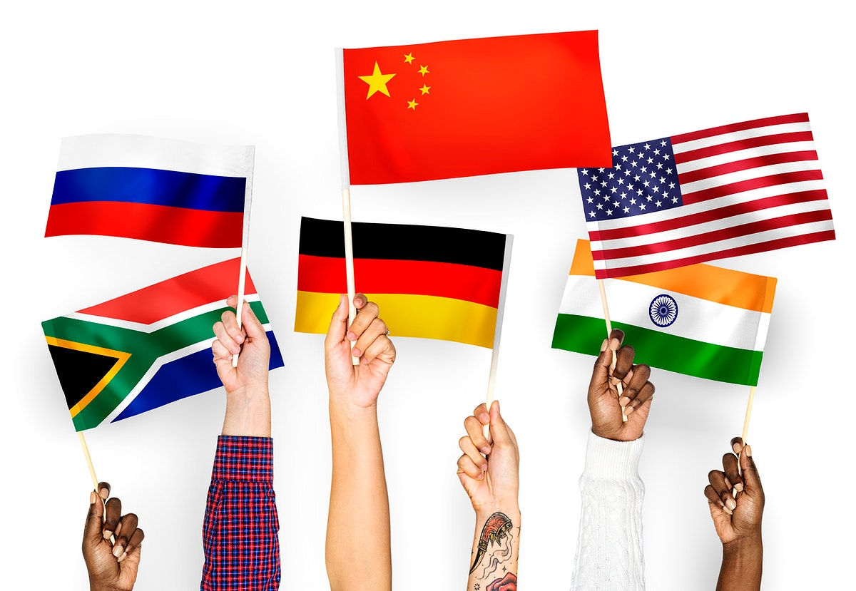 Hands waving flags of China, Germany, India, South Africa, and Russia