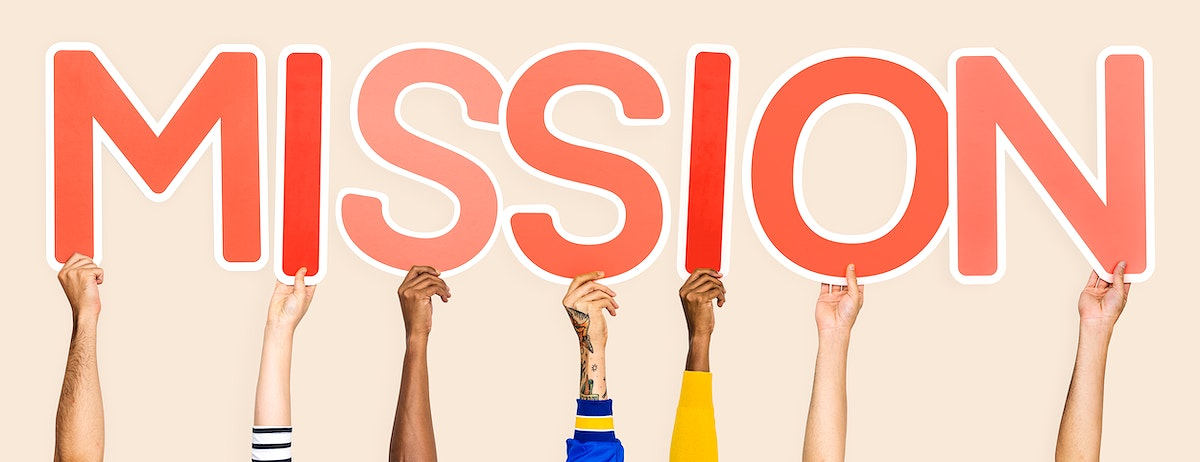 Diverse hands holding the word mission