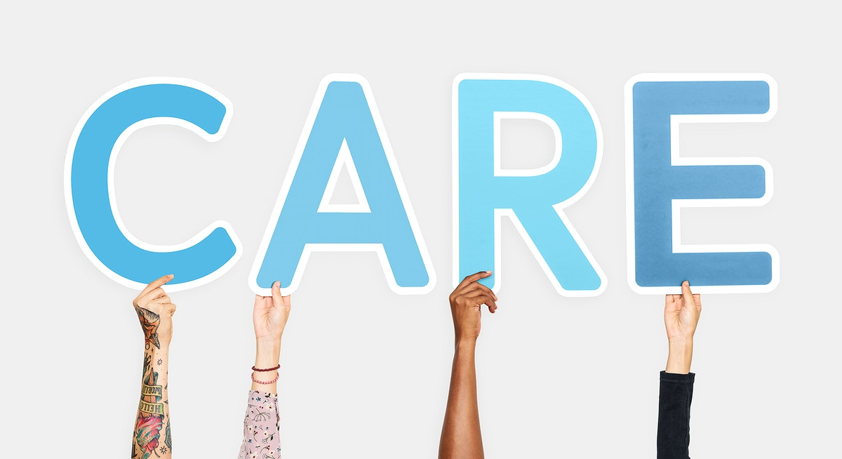Diverse hands holding the word care
