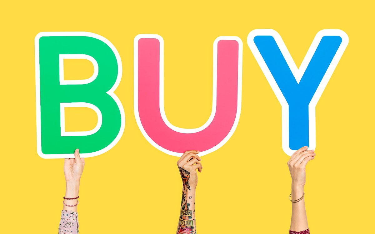 Hands holding the word Buy